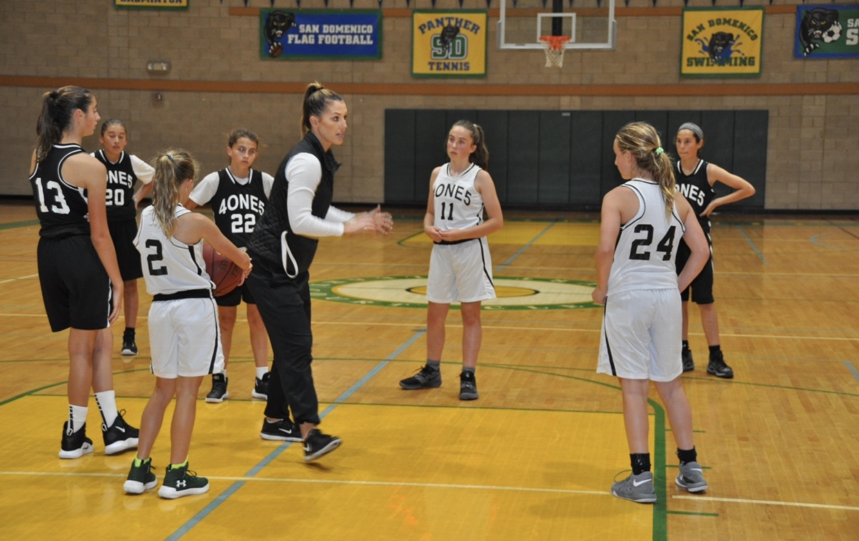 Stephanie Coaching Basketball